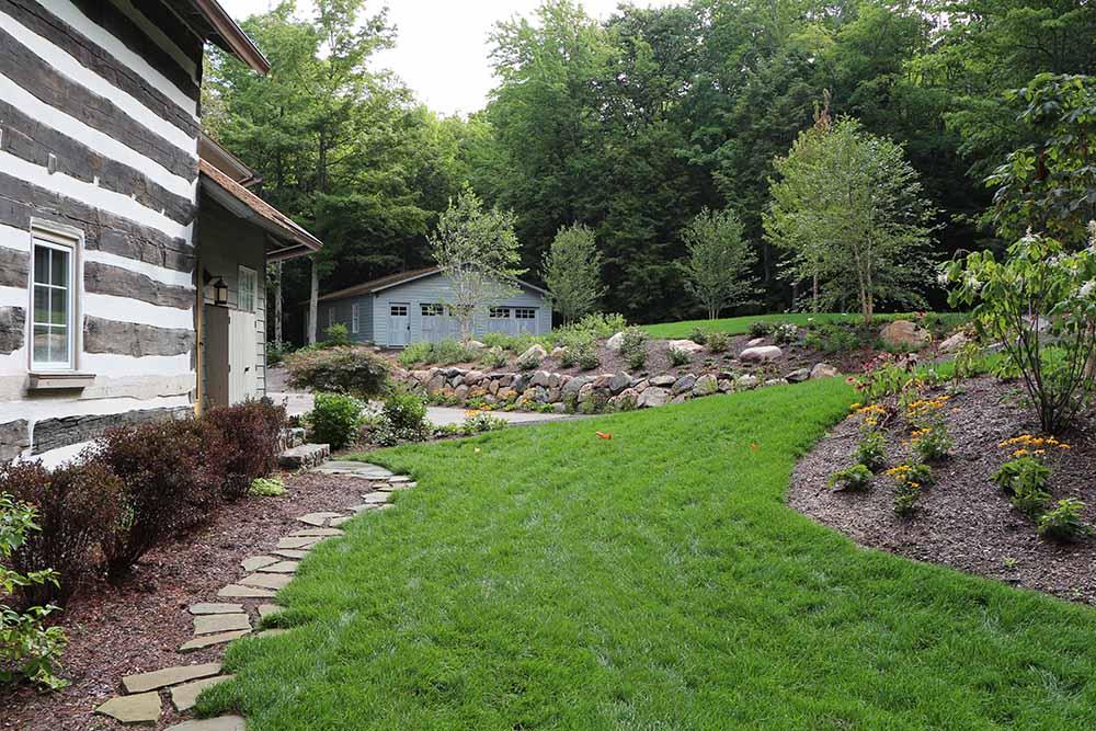 Landscape-beds-landscape-ideas-gardens-circular-drive-paver-pad-lake- Michigan-home - TruNorth Landscaping